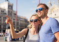 Tourists sightseeing beautiful young couple in city Stock Image