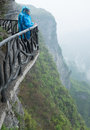 Tourists on sightseeing footpath in tianmen mountain china standing the famous and scary a steep cliff Royalty Free Stock Photography