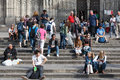 Tourists sit on the stairs of barcelona cathedral spain apr april in spain holy cross Stock Photography