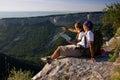 Tourists sitting on mountain Royalty Free Stock Photo