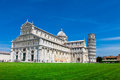 Tourists on Square of Miracles visiting Leaning Tower in Pisa, Italy Royalty Free Stock Photo