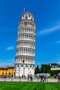 Tourists on Square of Miracles visiting Leaning Tower in Pisa Royalty Free Stock Photo