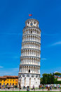 Tourists on Square of Miracles visiting Leaning Tower in Pisa, Italy. Royalty Free Stock Photo