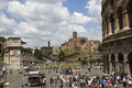 Tourists on the square near the colosseum and the arch of constantine in front of ruins of the temple of venus and rome italy Royalty Free Stock Photo