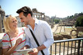 Tourists standing by the roman forum couple of using tablet Royalty Free Stock Photography