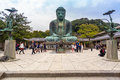 Tourists at statue of The Great Buddha of Kamakura, Japan