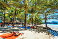 Tourists sunbathing on the sand of a tropical beach in the shade phuket thailand october surin palms surin is retreat for Stock Photo