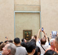 Tourists taking pictures of the mona lisa leonardo da vinci s famous in louvre museum in paris france Stock Photos
