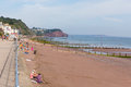 Tourists on teignmouth beach devon england holidaymakers enjoying the sunny warm weather Royalty Free Stock Photos