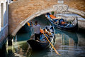 Tourists traveling on gondola on Venice canals Royalty Free Stock Photo