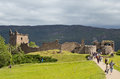 Tourists at urquhart castle ruined remains of scottish highlands Stock Photo