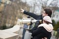 Tourists using telescope for sightseeing in paris Stock Photos