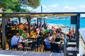 Tourists and various guests sitting at the bar by the sea and enjoy the sun in Zadar Royalty Free Stock Photo