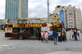 Tourists waiting departure of Big Bus Istanbul Tour Bus at Taksim Square Royalty Free Stock Photo