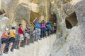 Tourists waiting on the steps in ancient times people carved out homes in fairy chimney rock formations in cappadocia turkey Royalty Free Stock Image
