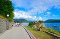 Tourists walk along promenade in Herceg Novi, Montenegro