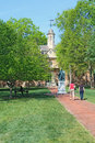 Tourists walk towards the wren building on the william and mary sir christopher campus of college of which is oldest Stock Photos