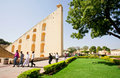 Tourists walking around weird architecture of the observatory Jantar Mantar Royalty Free Stock Photo