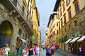 Tourists walking in crowded street in florence italy september strolling of old town after the rain Royalty Free Stock Photo