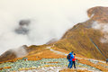 Tourists walking in a foggy day to the top of the Kasprowy Wierch in Tatra Mountains on Octo Royalty Free Stock Photo