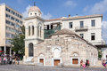 Tourists walking front pantanassa single tower church monastery monastiraki square downtown athens greece Stock Image
