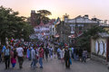 Tourists walking at street of Shimla town during sunset. Royalty Free Stock Photo