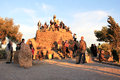 Tourists watch sunset popular hillside inside gaudi s parc guell barcelona spain photo shot november Stock Image