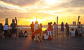 Tourists watching sunset singapore from a tower Royalty Free Stock Photography