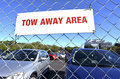 Tow away area sign in a parking lot Stock Photos