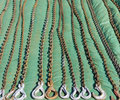 Tow chains rusty offered for sale at a carboot sale laid out in vertical lines on a green groundsheet Royalty Free Stock Photography