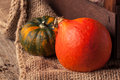 Tow mini pumpkins on old wooden table and sackcloth Stock Image