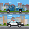 Tow truck and police car in urban landscape