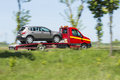 Tow truck transports to repair damaged vehicles Royalty Free Stock Photos