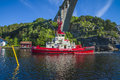 The towage of mv north sea giant has started tug achilles and tug belos have towing through ringdalsfjord in halden norway Stock Photography