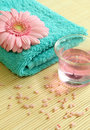 Towel, candle and pink gerber. Royalty Free Stock Photo