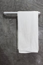 Towel on a hanger with concrete Wall Royalty Free Stock Photo