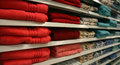 Towels bright red on shelves in a store Stock Images