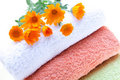 Towels And Calendula Flowers Royalty Free Stock Photos