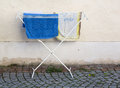 Towels drying on clothes horse old plastic used for and after washing outside in street Royalty Free Stock Photos