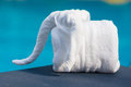 Towels in form of elephants on sunbed at luxury swimming pool Royalty Free Stock Photo