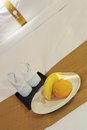 Towels and fruit on bed in a hotel room vertical Stock Image