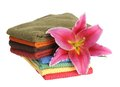 Towels and lily colorful flower isolated on white Stock Photos