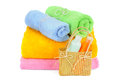 Towels and shampoo isolated on white background Royalty Free Stock Photos
