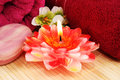 Towels, soap,  candle, flowers Royalty Free Stock Photo