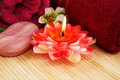 Towels, soap, flowers, candle Royalty Free Stock Photo