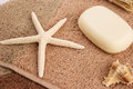 Towels with starfish shell soap horizontal closeup picture Stock Photography