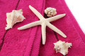 Towels with starfish shells horizontal closeup picture Stock Photo