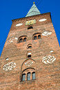 Tower of aarhus cathedral denmark the against a deep blue evening sky red bricks leaded windows and an old clock Stock Images