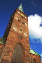 Tower of aarhus dome the red brick church against a deep blue summer sky Stock Photography