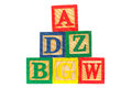 Tower of ABC wooden learning blocks on white Royalty Free Stock Image